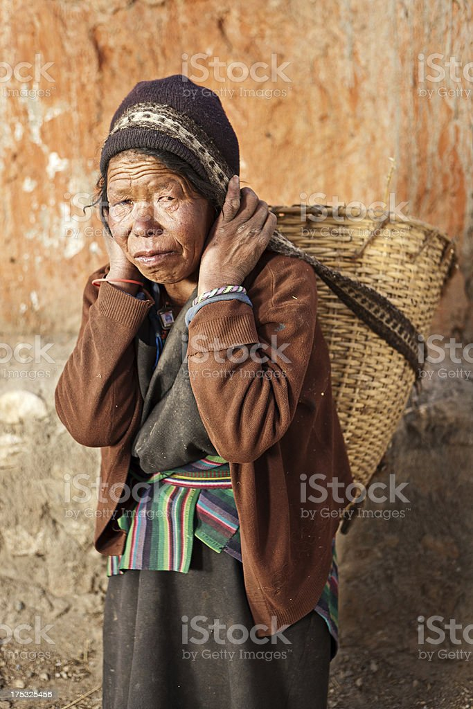 Tibetan woman carrying basket royalty-free stock photo