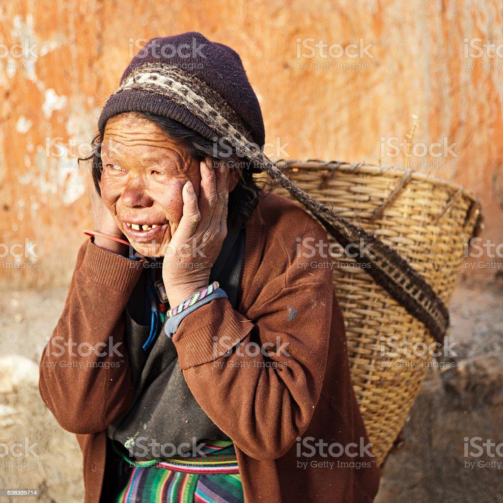 Tibetan woman carrying basket stock photo