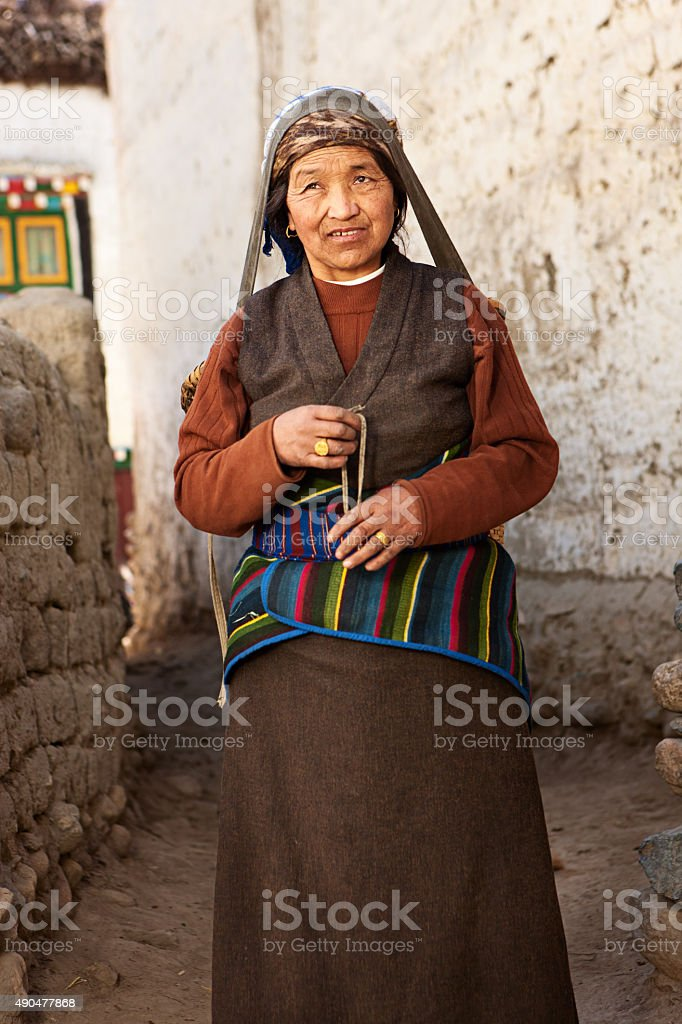 Tibetan woman carrying basket, Upper Mustang, Nepal stock photo