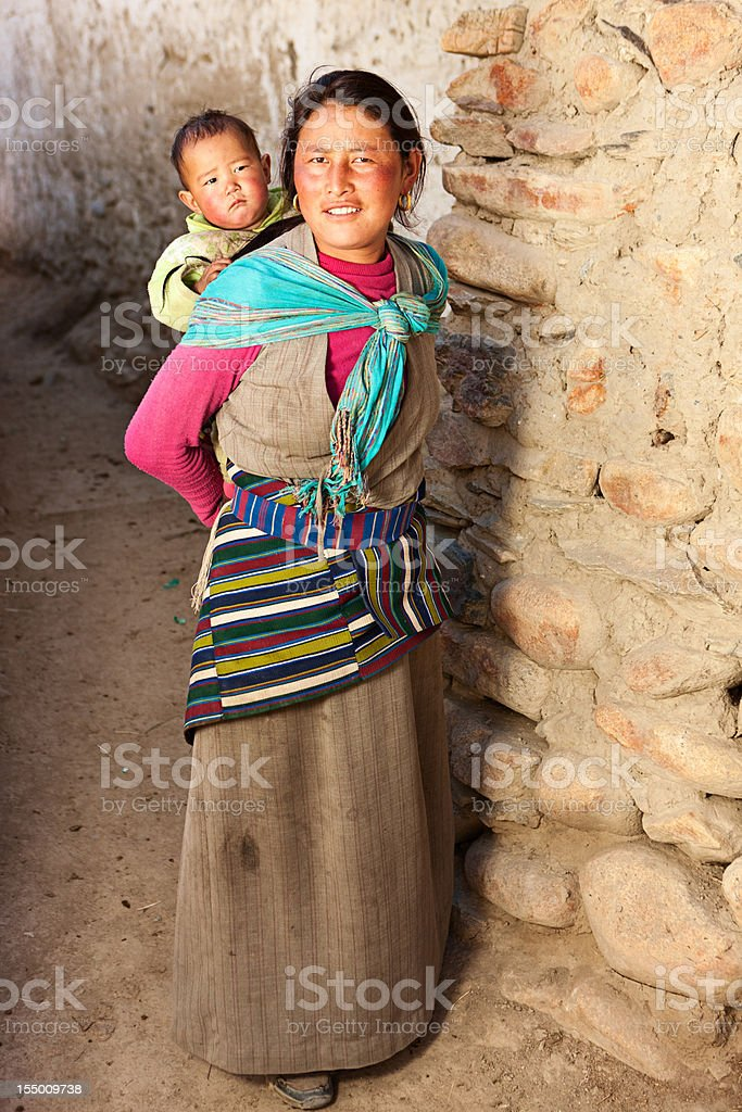 Tibetan woman carrying her baby royalty-free stock photo