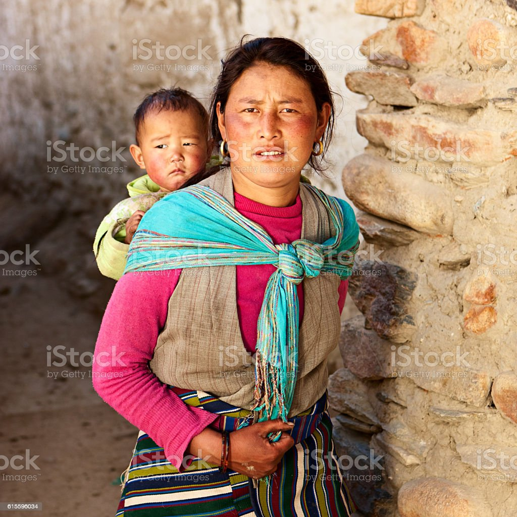 Tibetan woman carrying her baby, Upper Mustang stock photo