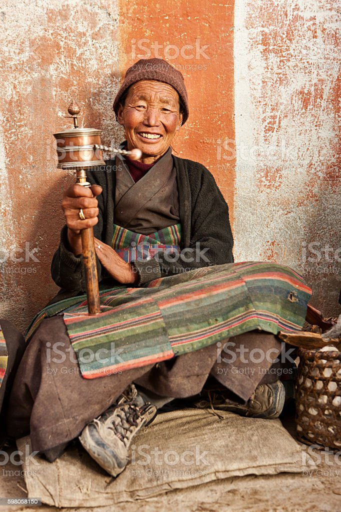 Tibetan woman holding praying wheel, Upper Mustang stock photo