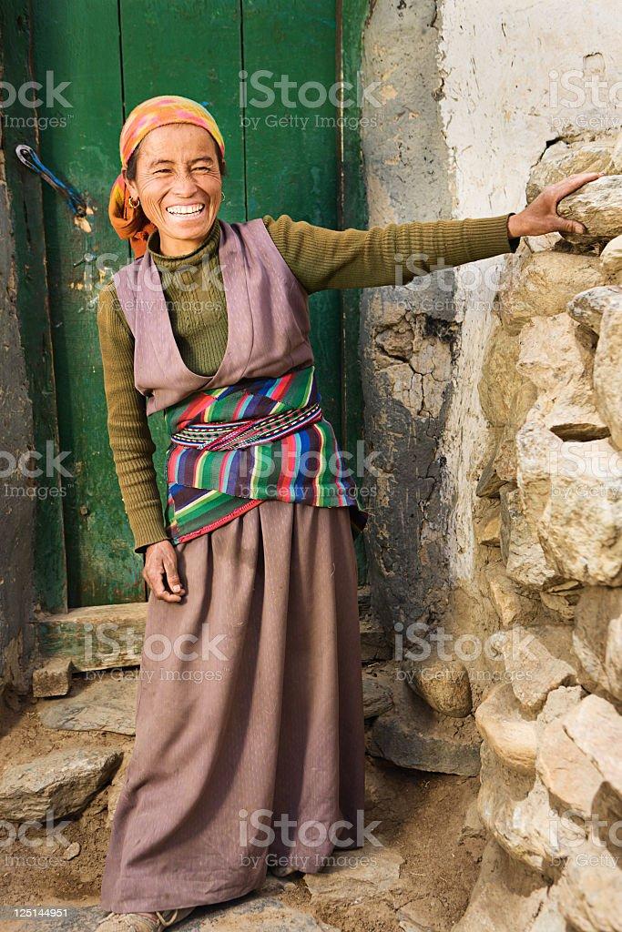 Tibetan woman in Mustang region royalty-free stock photo