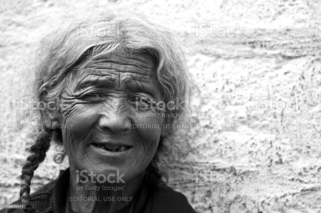 Tibetan Woman outside Johkkan Temple. stock photo