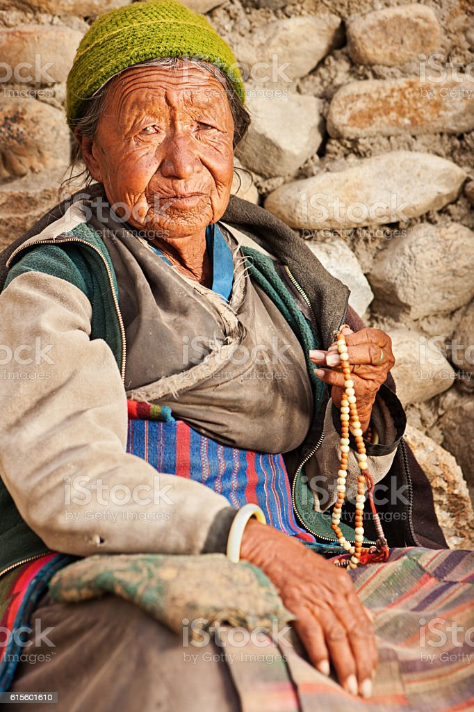 Tibetan woman praying with rosary, near Lo Manthang stock photo
