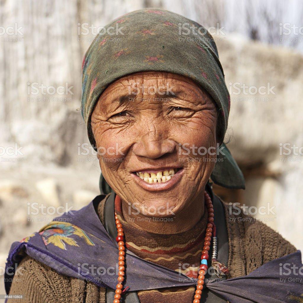 Tibetan woman praying with rosary. royalty-free stock photo