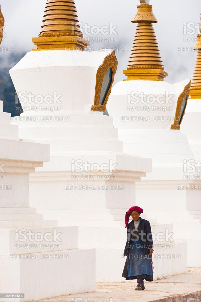 Tibetan Woman Walking Large Chortens Stupas Deqin royalty-free stock photo