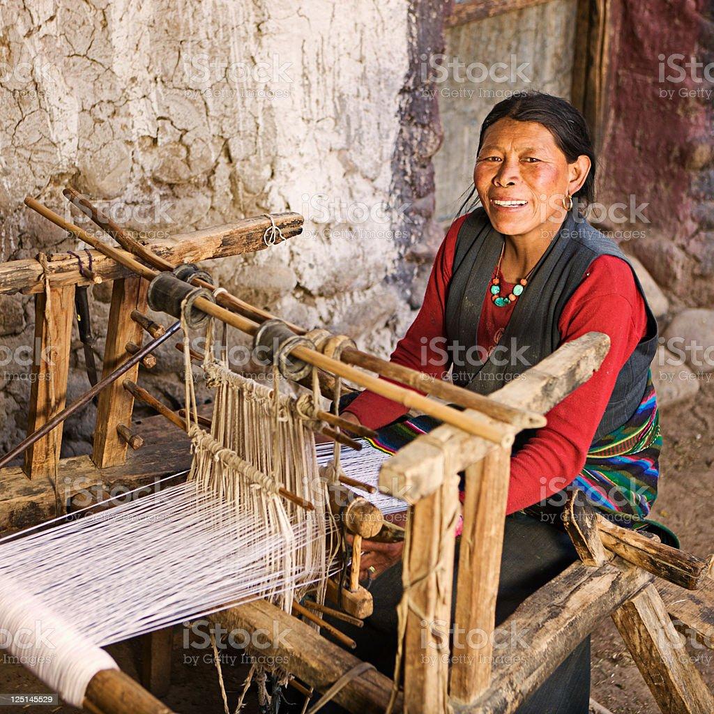 Tibetan woman weaving a carpet royalty-free stock photo