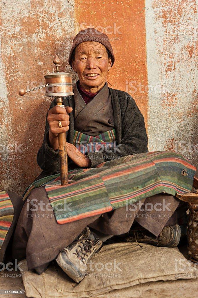 Tibetan woman with prayer wheel royalty-free stock photo