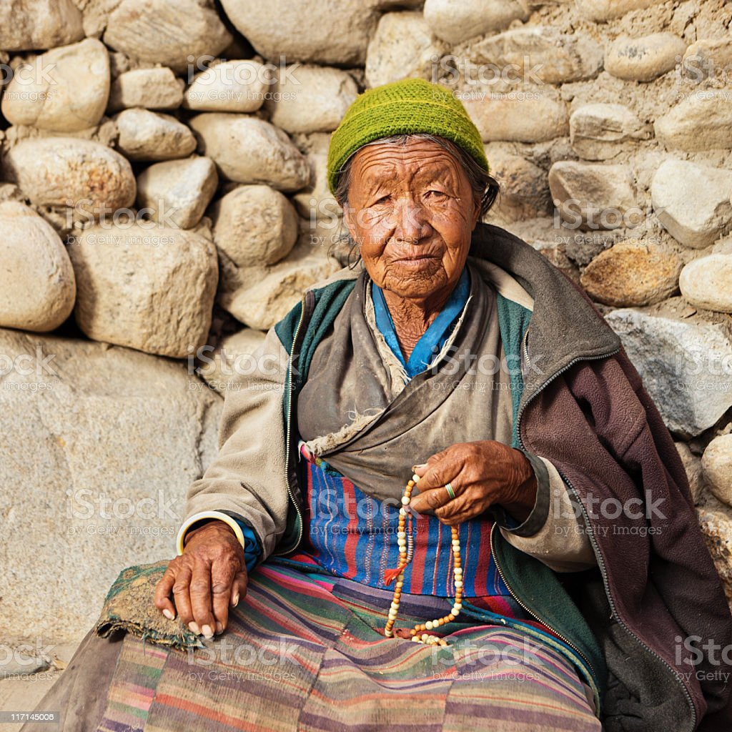 Tibetan woman with rosary royalty-free stock photo