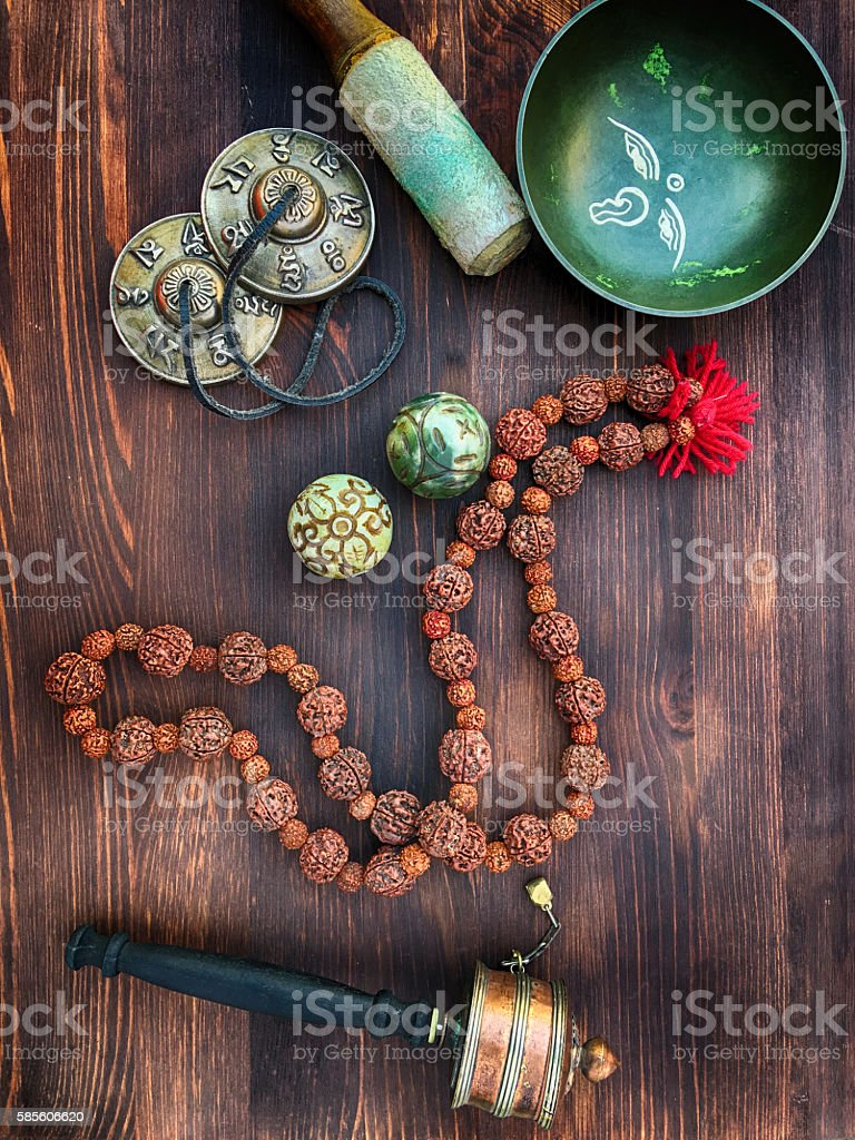 tibetian singing bowls,religious drums, beads and plates, view f stock photo