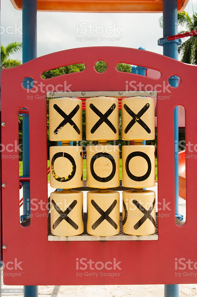 Tic Tac Toe top and bottom row crosses middle zero royalty-free stock photo
