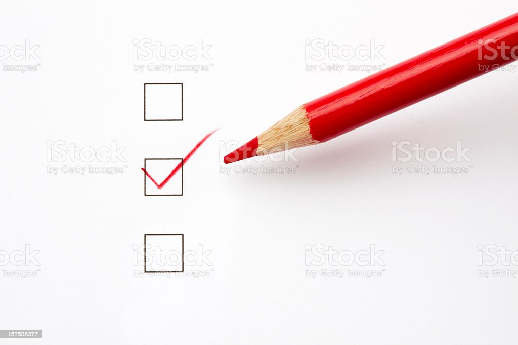 Tick boxes with red crayon marking a red tick royalty-free stock photo
