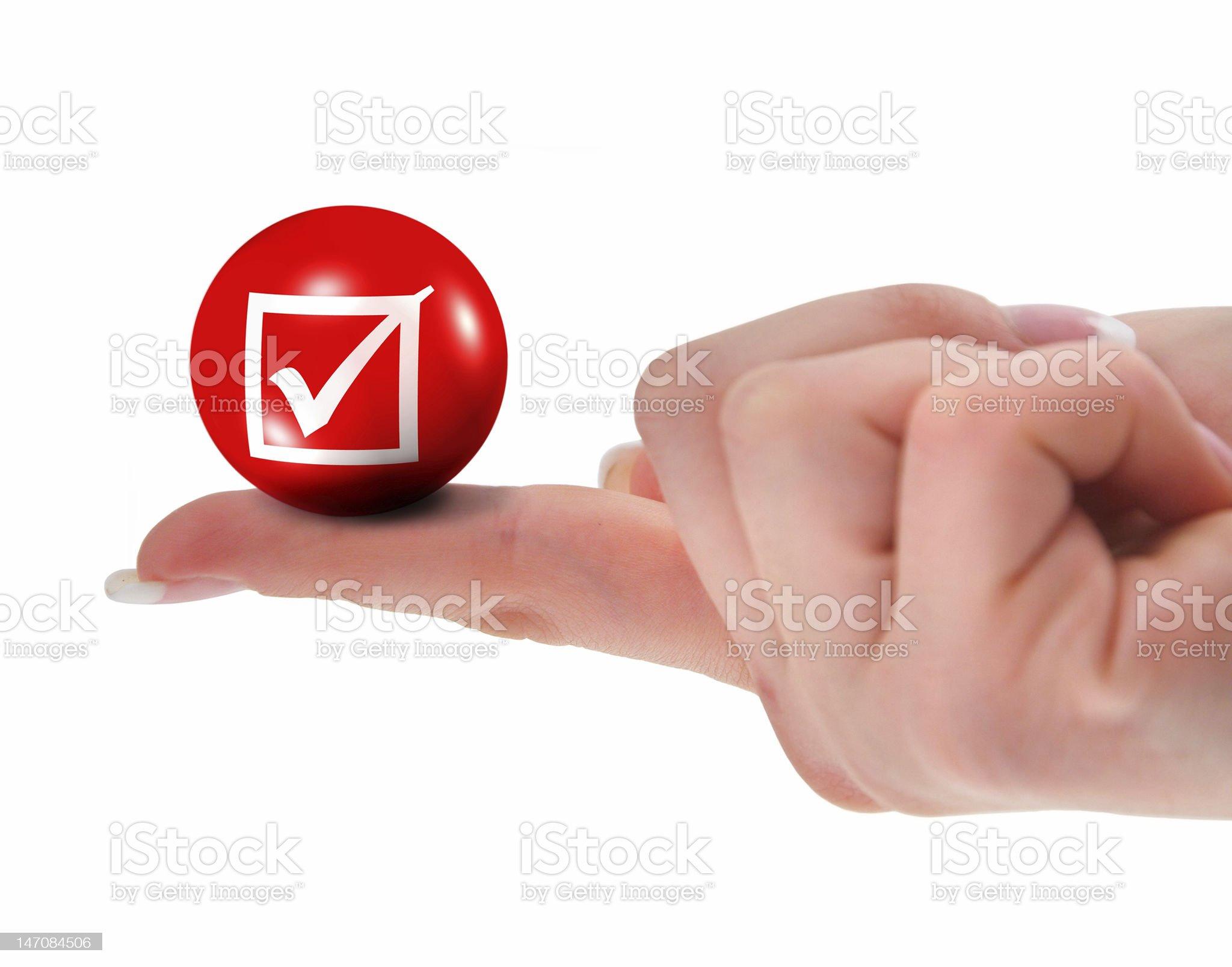 tick sign on finger shallow DOF royalty-free stock photo