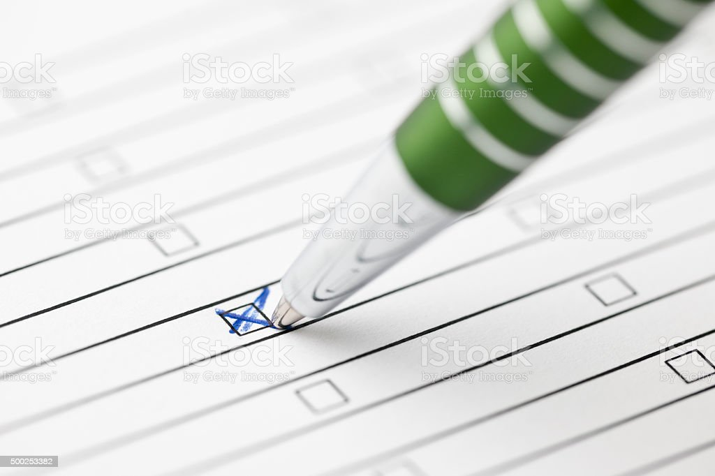 ticked with green pen_middle focus stock photo