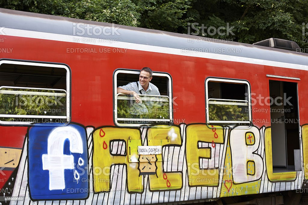 Ticket collector looking out of window from Slovenian train royalty-free stock photo
