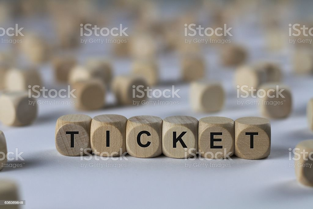 ticket - cube with letters, sign with wooden cubes stock photo
