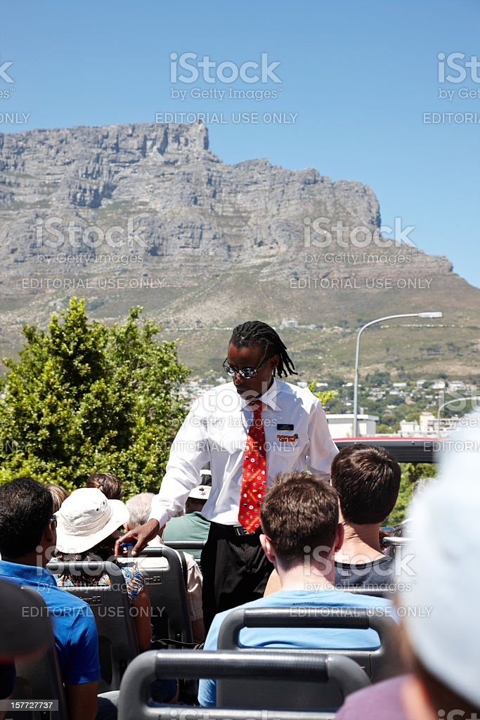 Ticket inspector on Cape Town tourist bus stock photo