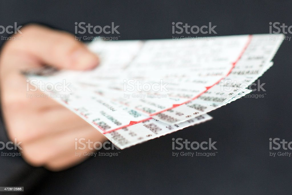 Tickets in hand stock photo