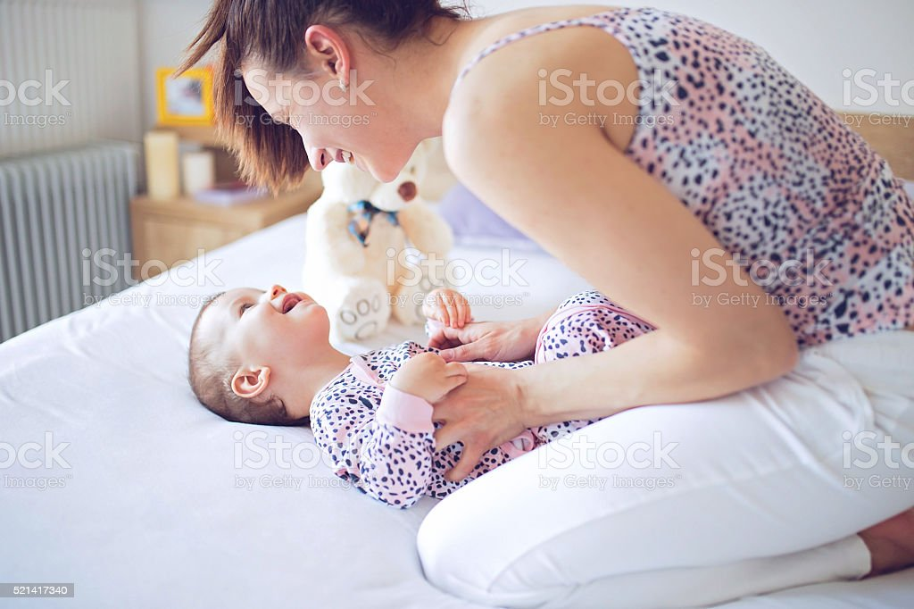 Tickling baby stock photo