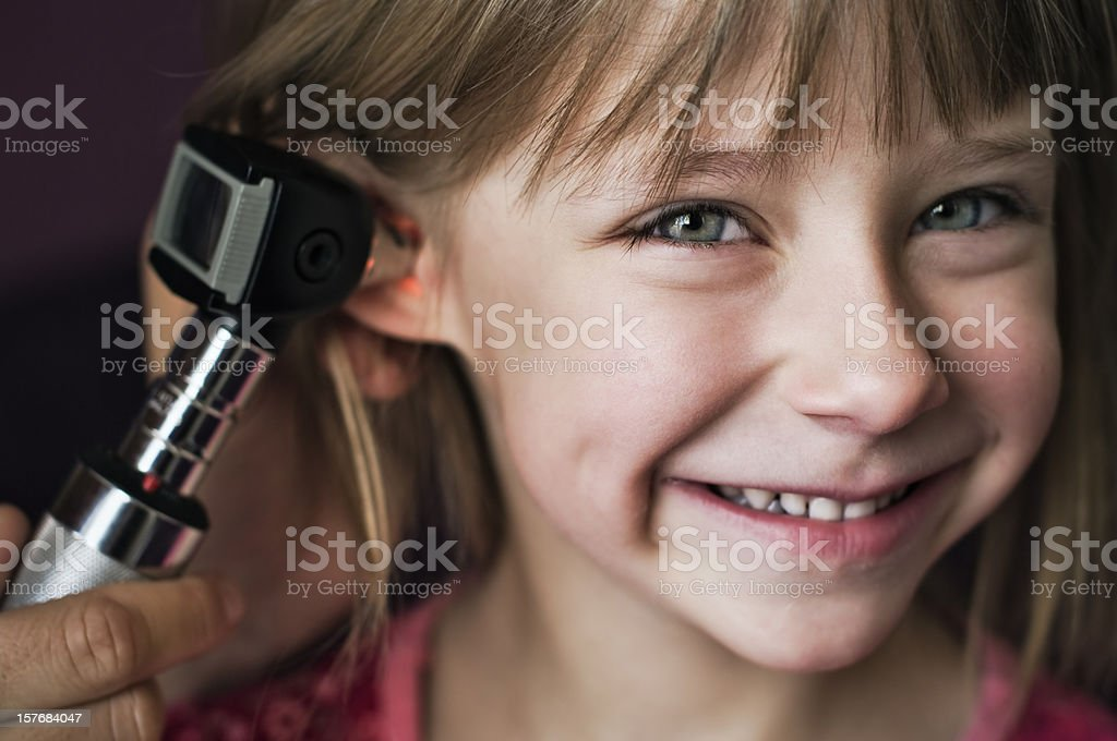 Tickling ear exam stock photo