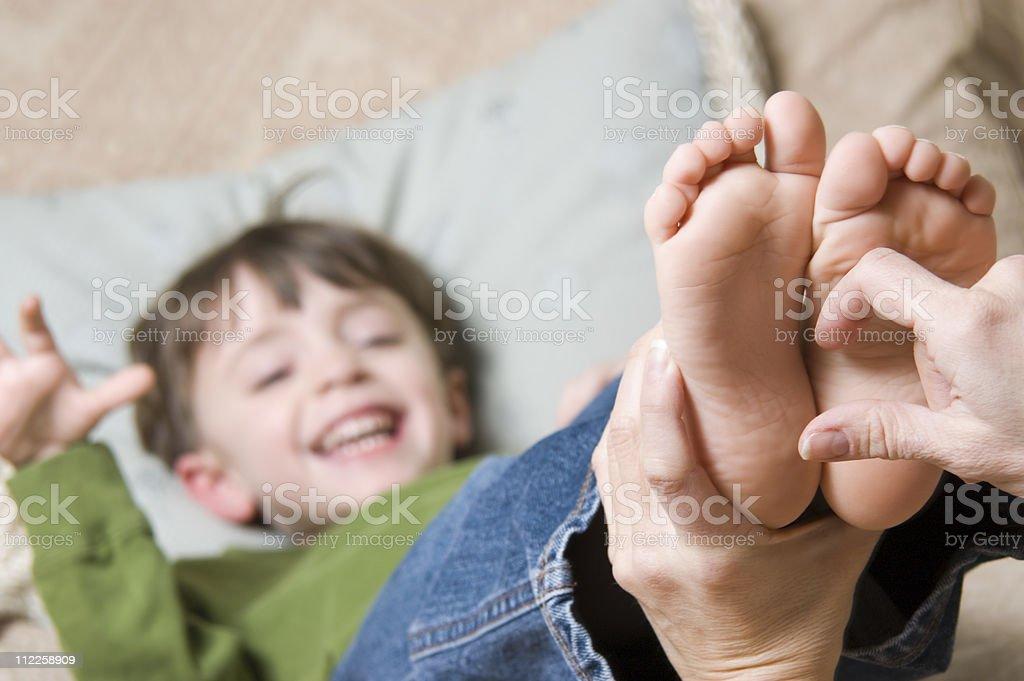 Tickling Feet royalty-free stock photo