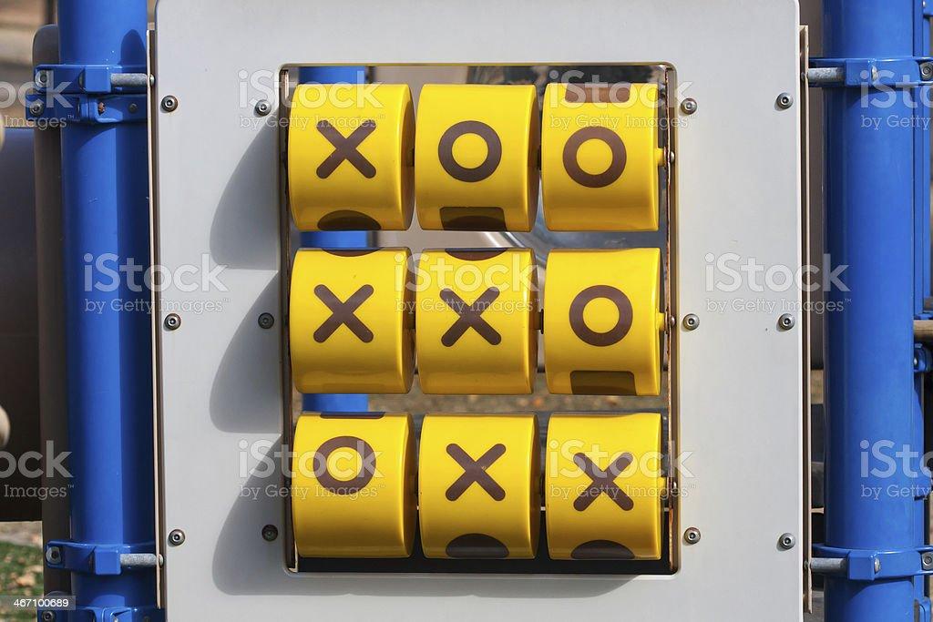 Tick-tack-toe game at playground stock photo