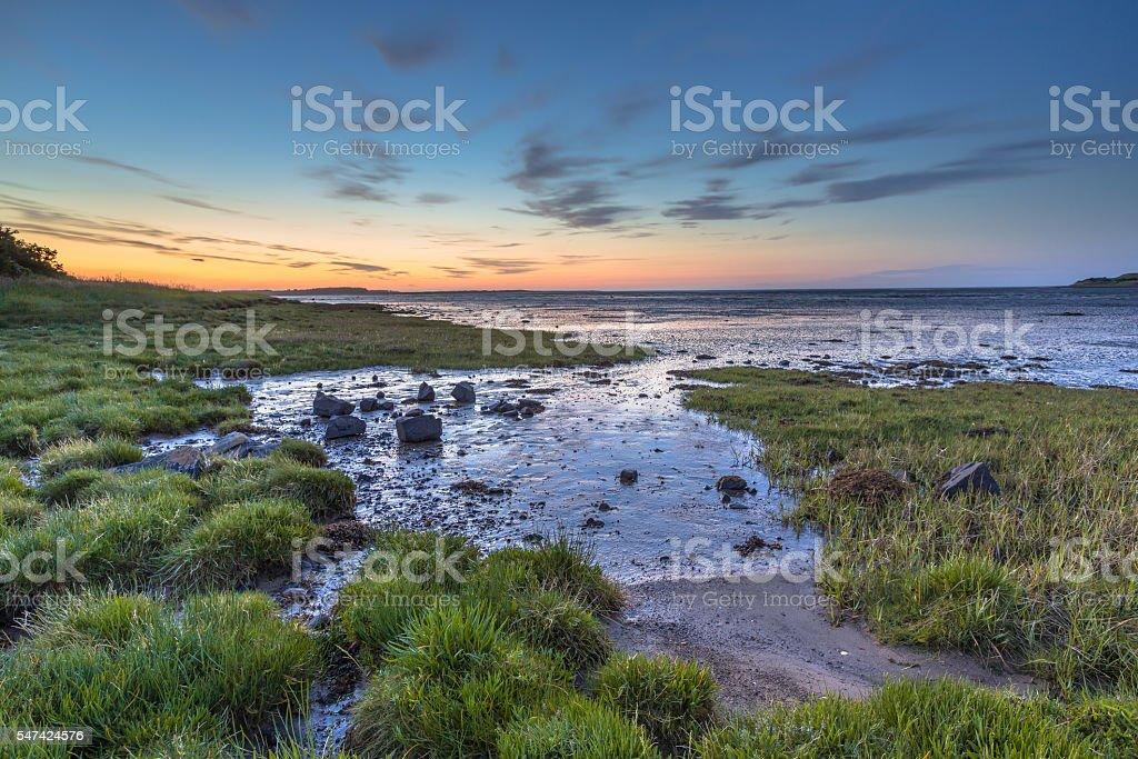 Tidal marsh Sea Inlet sunset stock photo