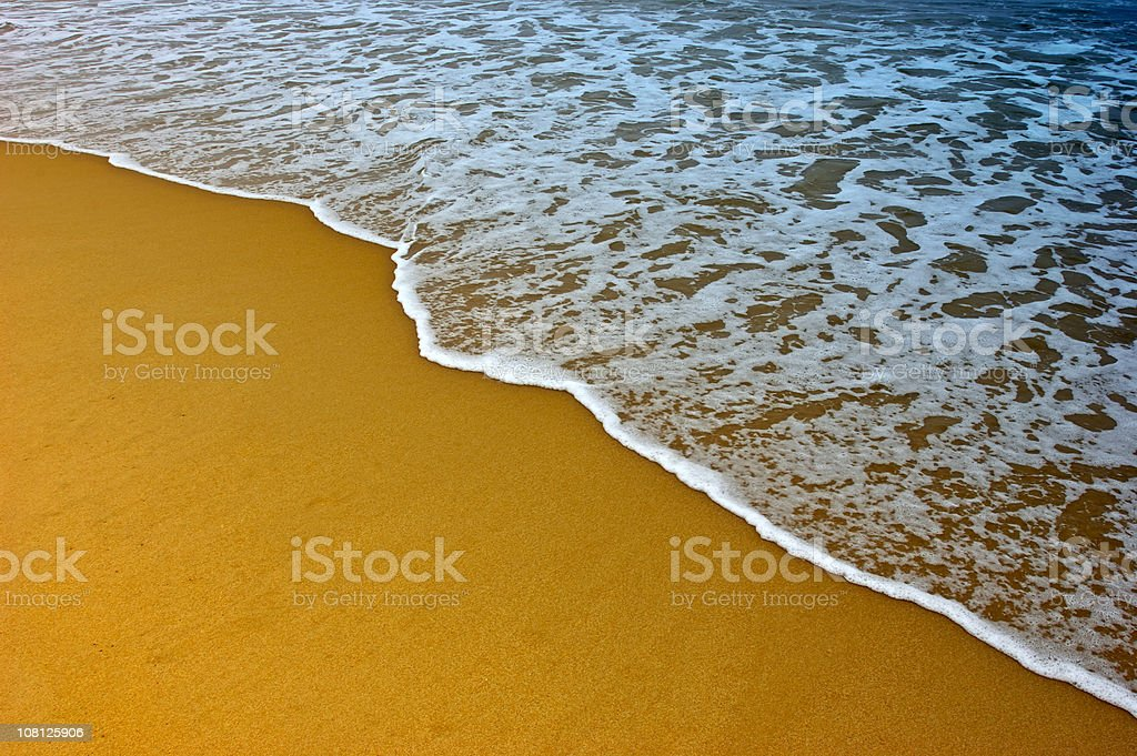 Tide Coming In On Golden Sand Beach royalty-free stock photo