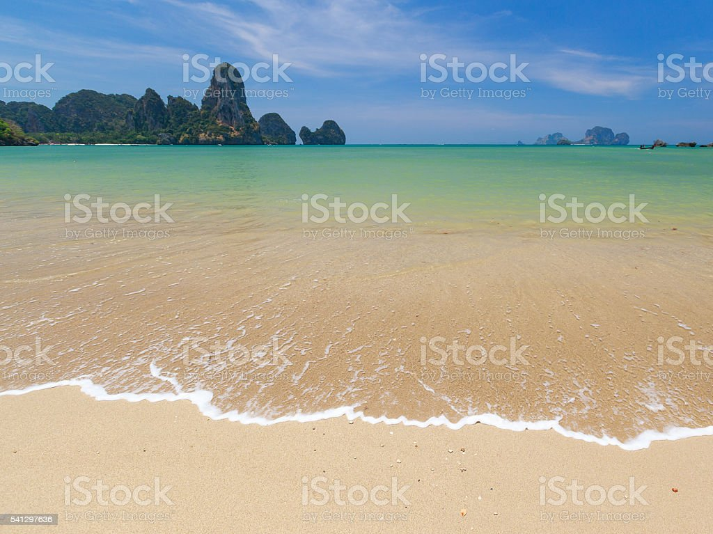 Tide on a beach in Thailand stock photo