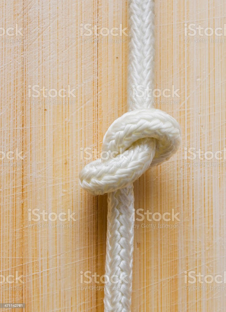 Tide simple knot on wood royalty-free stock photo