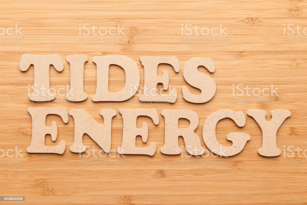 Tides Energy word with wooden letters stock photo