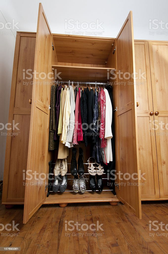tidy clothes and shoes in woman's wardrobe royalty-free stock photo