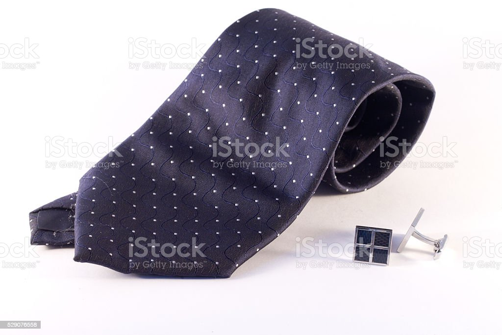 Tie and cufflinks stock photo
