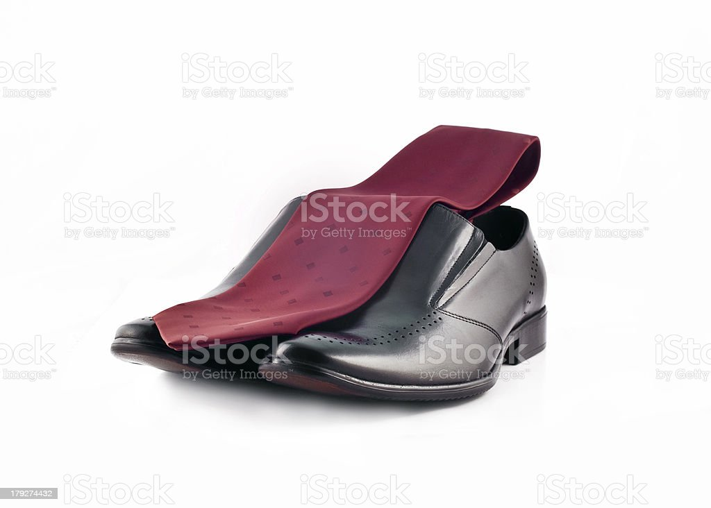 Tie and Pair of man's classic shoes isolated over white royalty-free stock photo