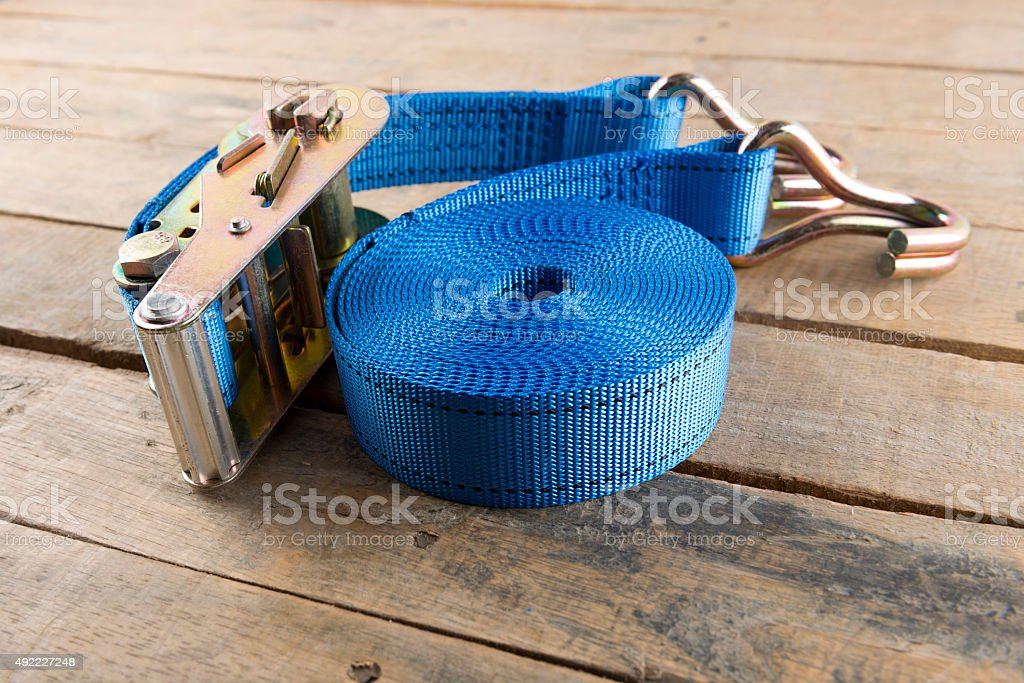 tie down strap ratchet on wood stock photo