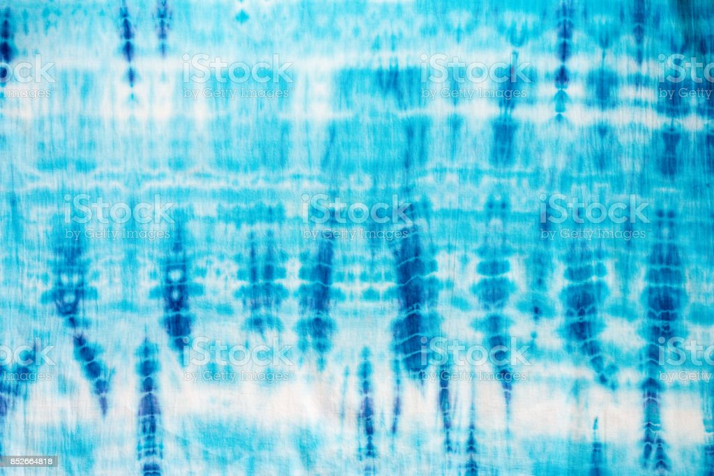 blue color tie dye pattern on cotton fabric background