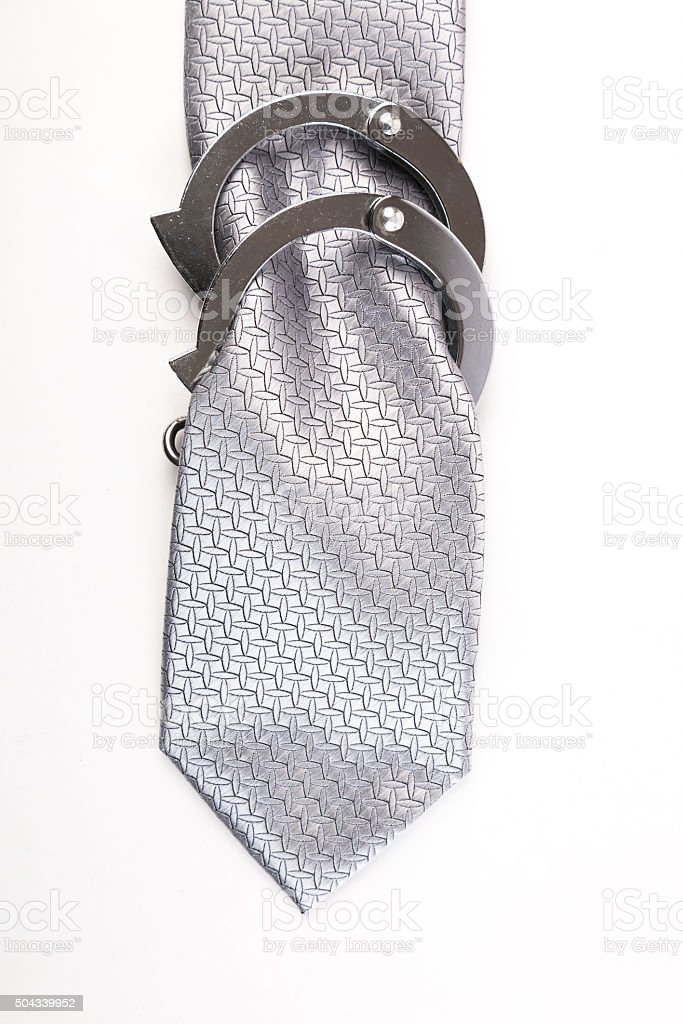 Tie with handcuffs stock photo