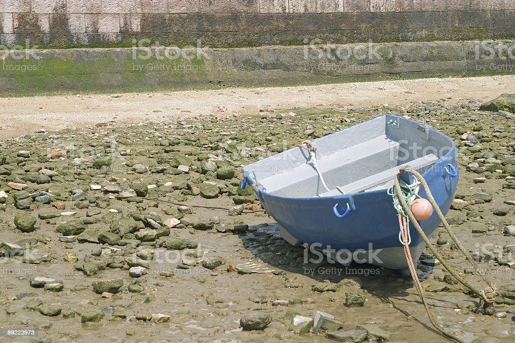 Tied down boat with low tide royalty-free stock photo