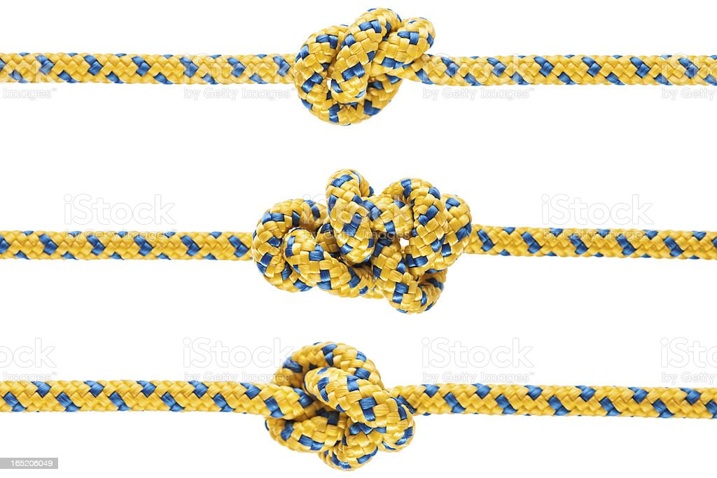 Tied knot on rope or spring royalty-free stock photo