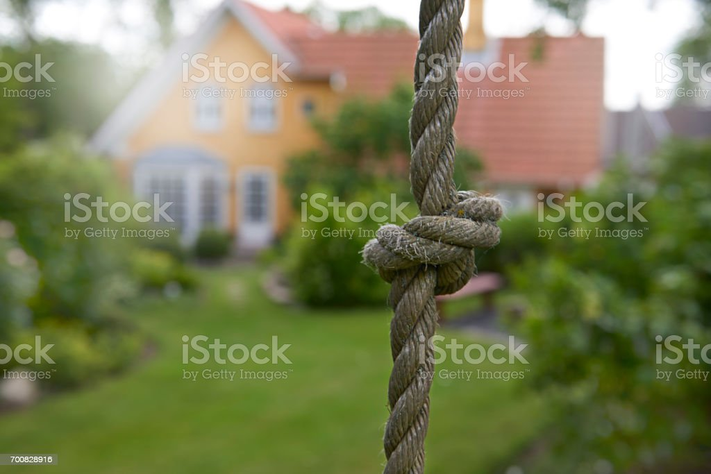 Tied knot on thick rope for climbing stock photo