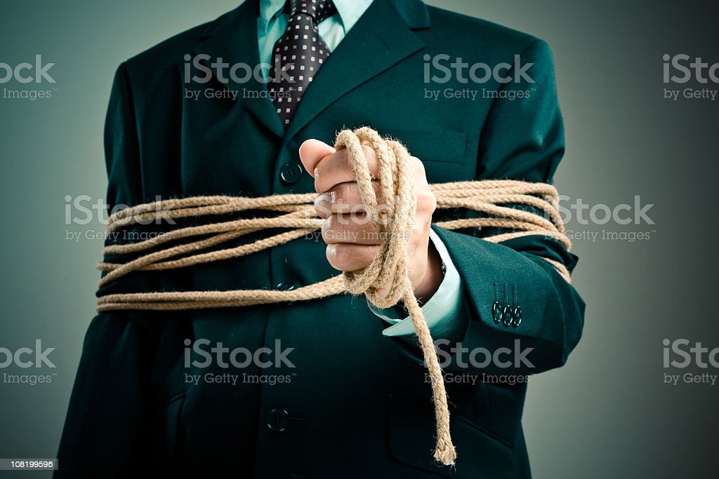Tied up businessman stock photo