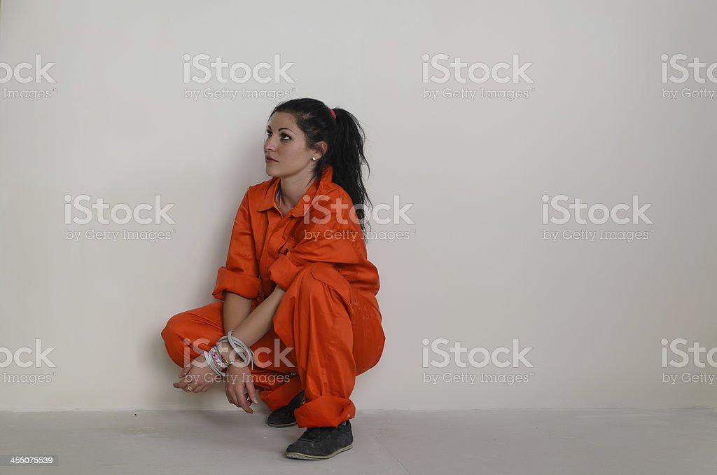 Tied up crouching woman stock photo