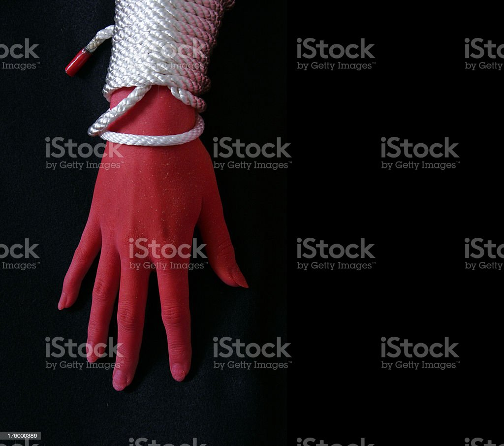 Tied up, Red handed stock photo