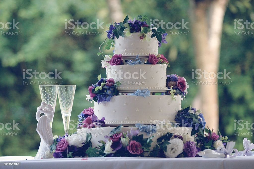 3 tiered white wedding cake stock photo