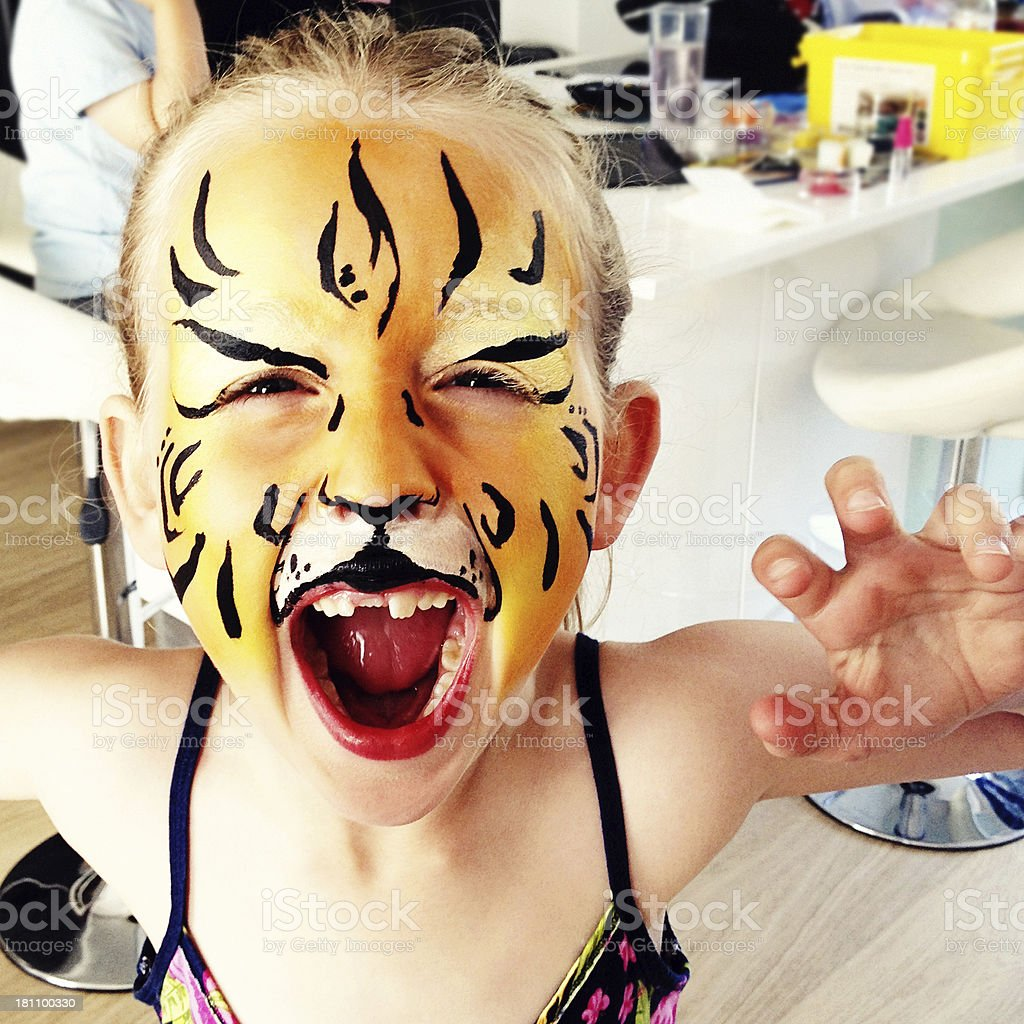 Tiger Face Paints royalty-free stock photo