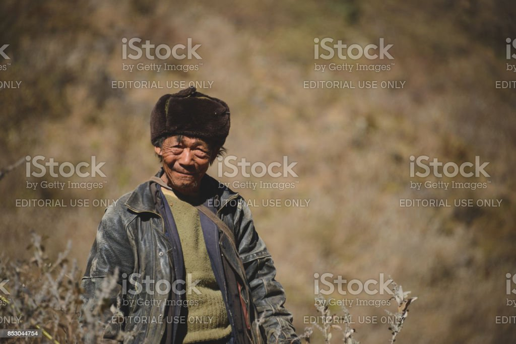Tiger Leaping gorge man stock photo