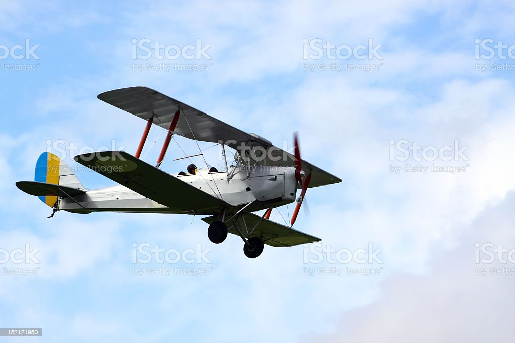 Tiger Moth plane flying through clouds stock photo
