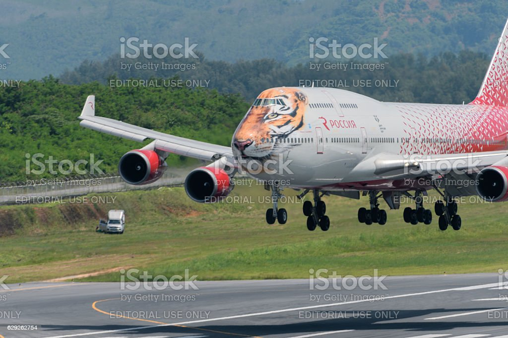 Tiger paint Rossiya airline landing at Phuket airport stock photo