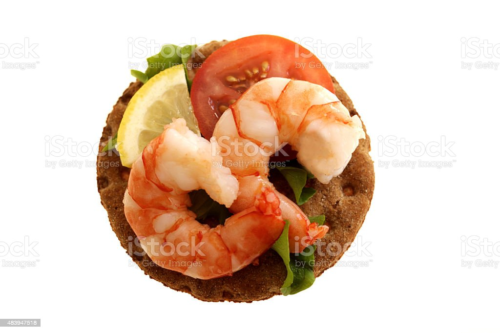Tiger Prawn on Rye Cracker Biscuit stock photo